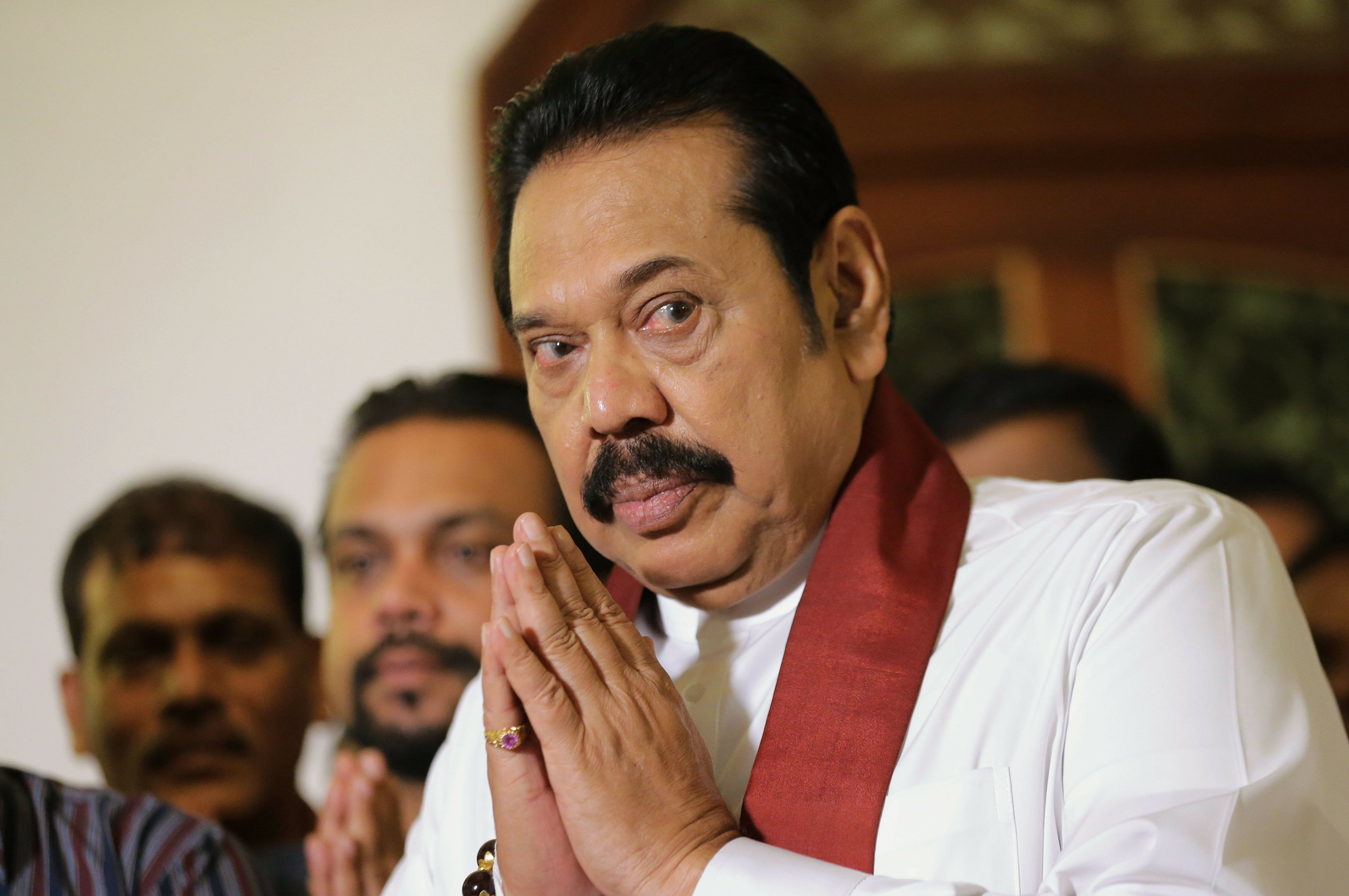 Sri Lanka's disputed prime minister resigns to end impasse
