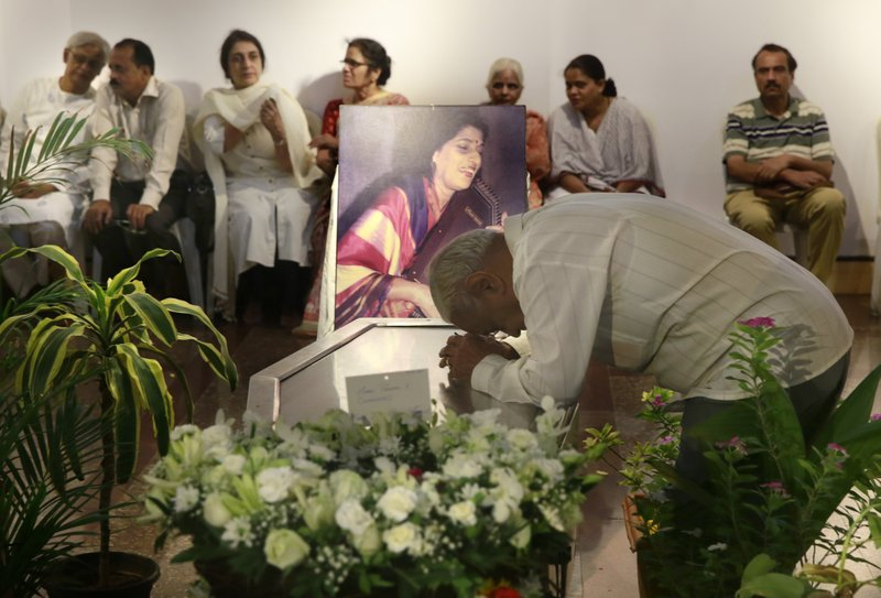 A man pays his last respect to classical Indian musician Kishori Amonkar in Mumbai, India, Tuesday, April 4, 2017. Amonkar, renowned for her innovative interpretation of classical Indian music, has died, one of her students said Tuesday. She was 84.
