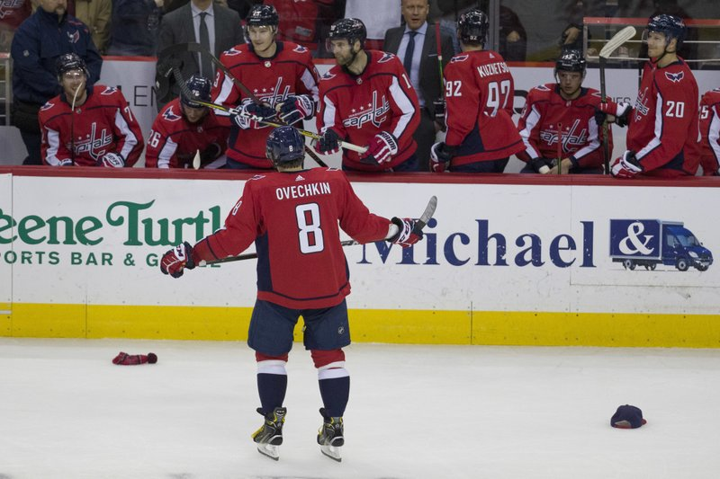 promo code d514f 4c730 Washington Capitals left wing Alex Ovechkin (8), from Russia, celebrates  his goal for a hat trick in the third period of an NHL hockey game against  the ...