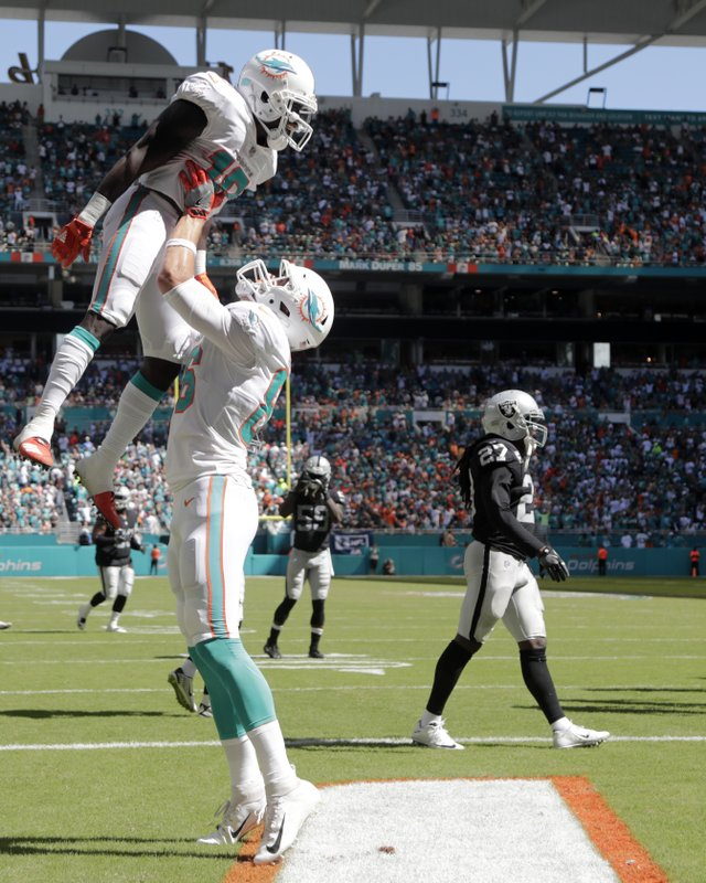 Trick plays help unbeaten Dolphins beat Raiders 28-20