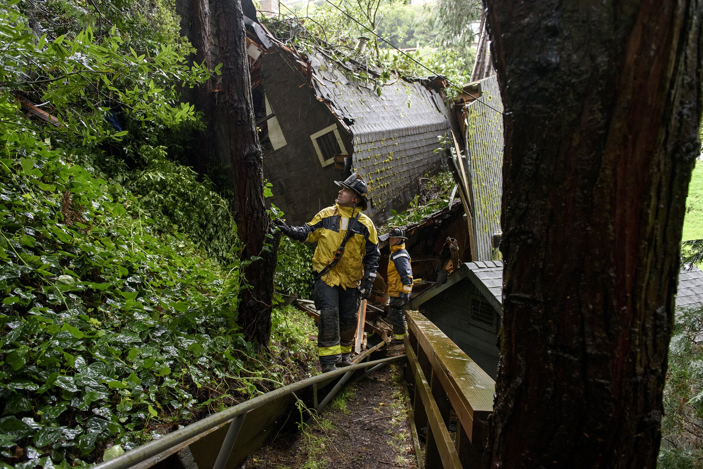 Mudslide sweeps house off hill as storm pounds California