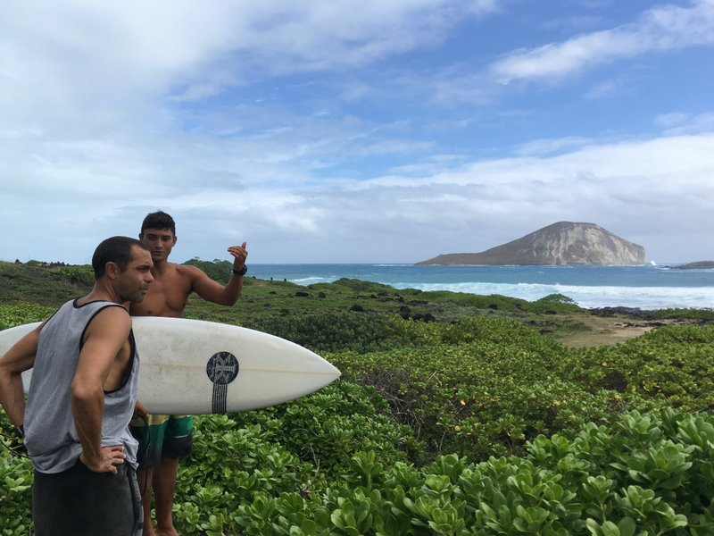 Hopena Pokipala Carries A Surfboard While Discussing Wave Conditions With Kaipo Guerreo At Makapuu Beach In Waimanalo Hawaii On Saturday Sept 3 2016