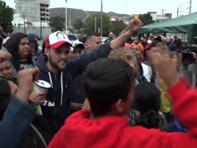 Raw: Some Caravan Migrants Allowed Into US
