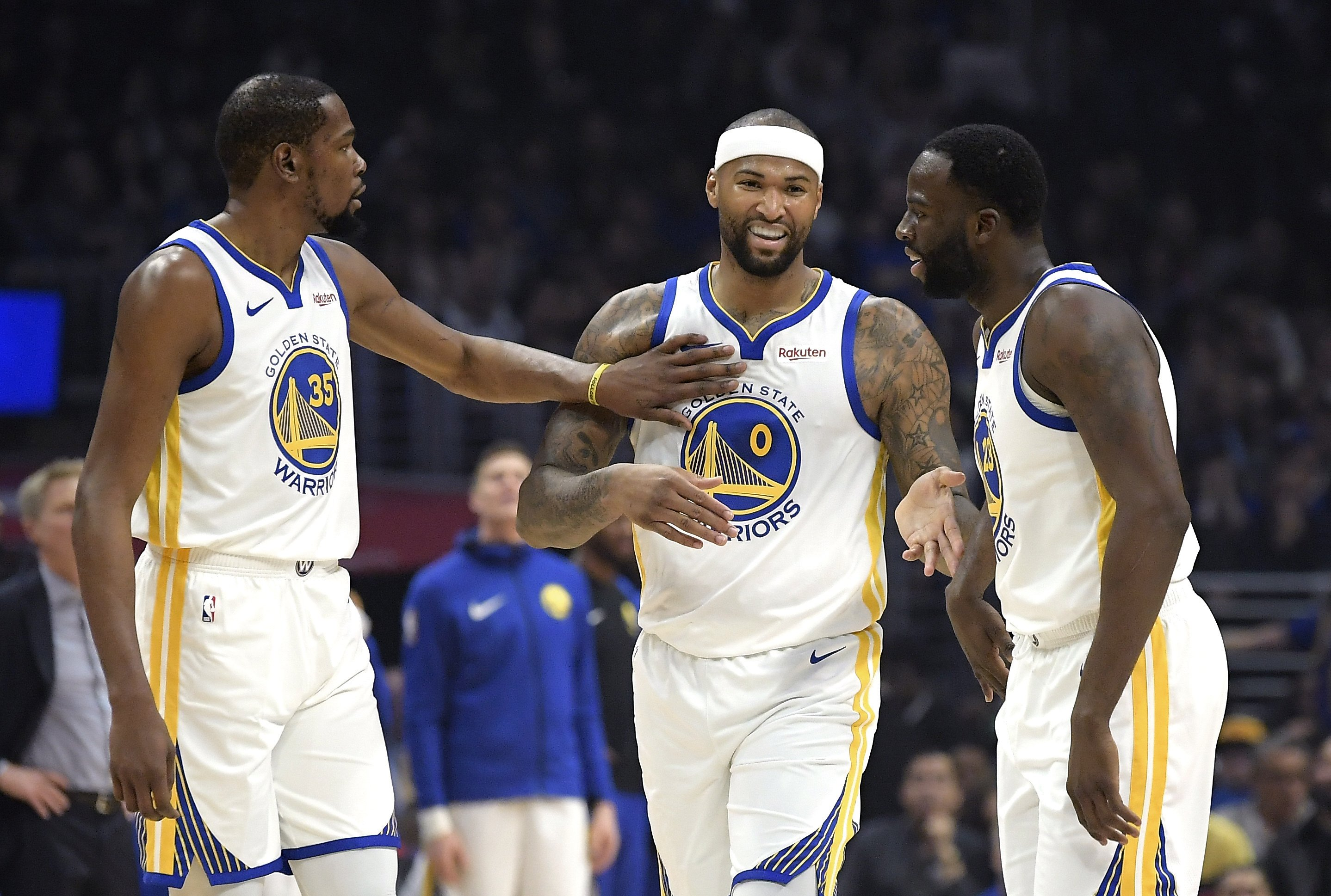 sports shoes b66b5 3036a Boogie Cousins overcomes nerves in 1st game with Warriors