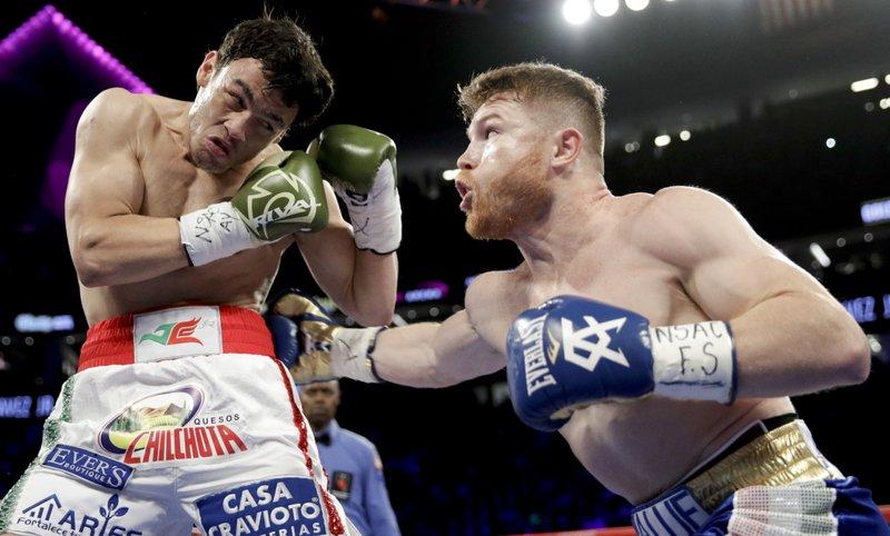 4ed4e1bd7837d  Canelo  Alvarez dominates Chavez Jr.