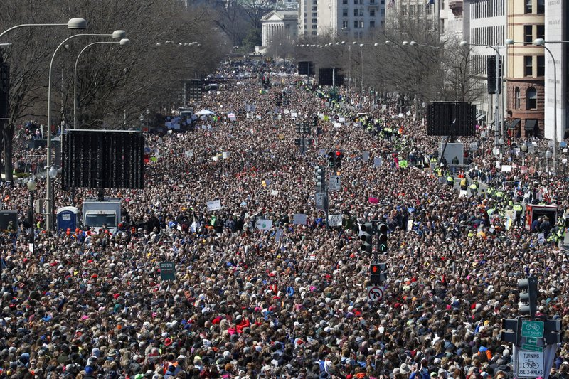 Tens of thousands gather for gun control