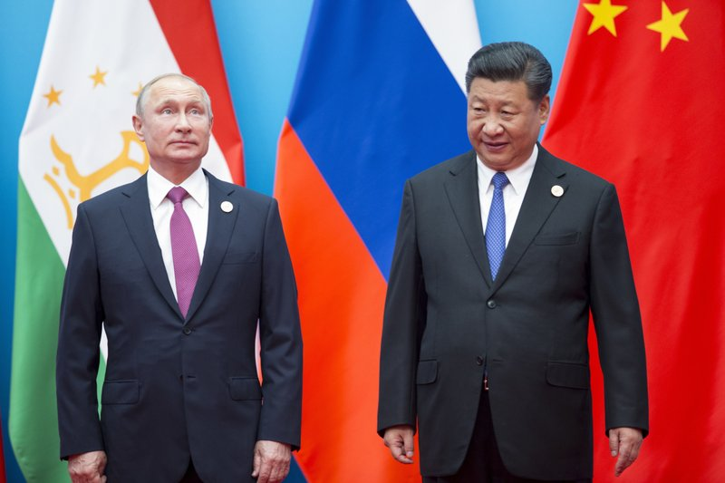 US policy drives Russia, China together ahead of summit