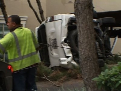 TX Woman OK After SUV Plunges Off Parking Garage