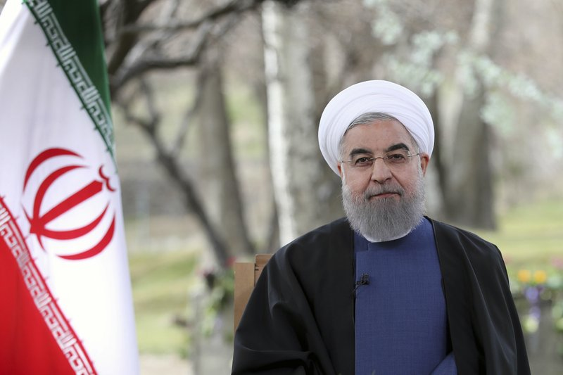 In this photo released by official website of the Iranian Presidency on Monday, March 20, 2017, President Hassan Rouhani poses for a portrait in a session to deliver a message for the Iranian New Year, Iran. Nowruz, a festival to celebrate the new Persian year starts with the spring. Iranians follow the Persian solar year, and this year, they begin the year 1396.
