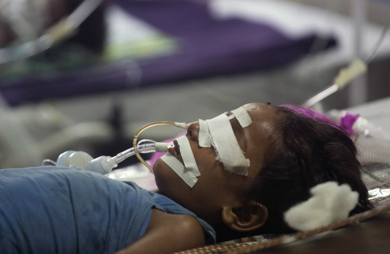 In this Aug. 13, 2017 file photo, a child receives treatment at the state-run Baba Raghav Das Medical College Hospital in Gorakhpur, Uttar Pradesh, India. The government hospital in north India where dozens of babies died within two days earlier this month said on Wednesday, Aug. 30, that at least 217 children died there in the month of August due to a variety of reasons including an annual encephalitis outbreak.