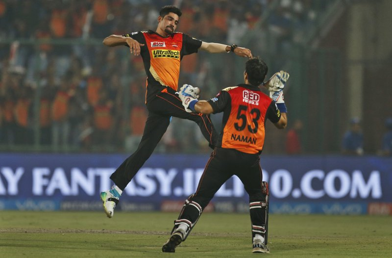 Sunrisers Hyderabad's bowler Mohammed Siraj, left, celebrates the wicket of Delhi Daredevils' batsman Rishabh Pant during their Indian Premier League (IPL) cricket match in New Delhi, India, Tuesday, May 2, 2017.