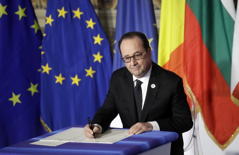 French President Francois Hollande signs a declaration during an EU summit meeting at the Orazi and Curiazi Hall in the Palazzo dei Conservatori in Rome on Saturday, March 25, 2017. European Union leaders were gathering in Rome to mark the 60th anniversary of their founding treaty and chart a way ahead following the decision of Britain to leave the 28-nation bloc.