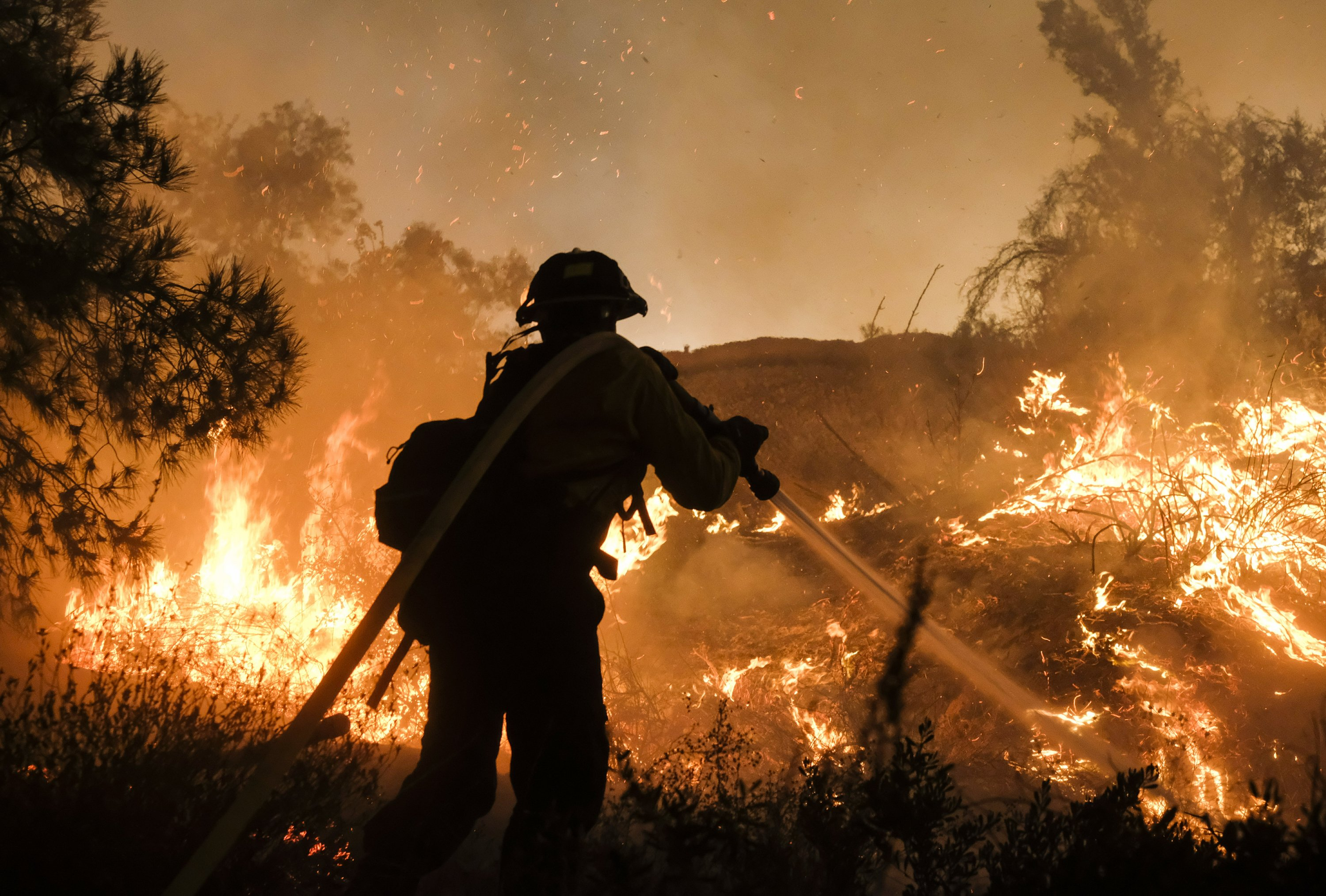 Flames inch close to California homes as thousands evacuate