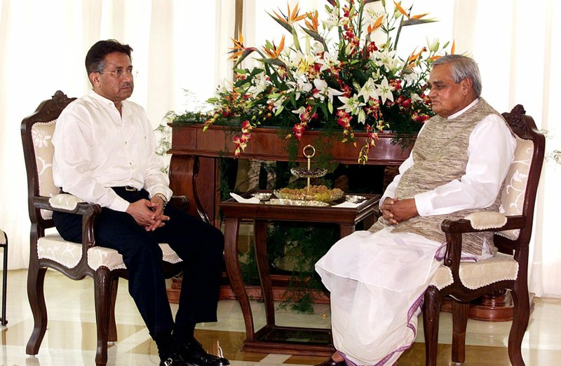 In this July 15, 2001, file photo, Pakistani President Gen. Pervez Musharraf, left, begins talks with Indian Prime Minister Atal Bihari Vajpayee in Agra, India. Vajpayee and Musharraf met in the Indian city of Agra, but reached no agreements over Kashmir or other disputes.