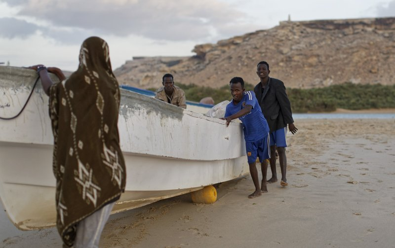 In This Photo Taken Tuesday March 7 2017 Fishermen Push Their Boats Into The Indian Ocean Shortly After Dawn In The Former Pirate Village Of Eyl