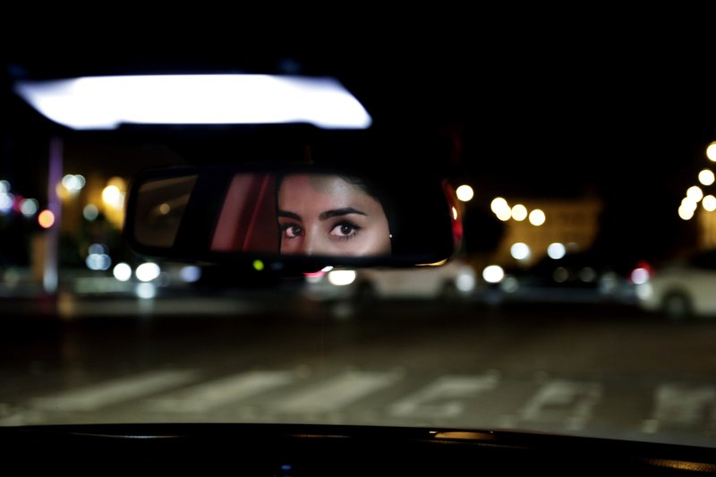 Hessah al-Ajaji drivers her car down the capital's busy Tahlia Street after midnight for the first time in Riyadh, Saudi Arabia, Sunday, June 24, 2018. Saudi women are in the driver's seat for the first time in their country and steering their way through busy city streets just minutes after the world's last remaining ban on women driving was lifted on Sunday.