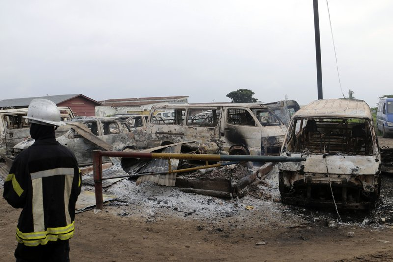 Burned minivans are seen outside the main prison in Kinshasa, Congo, Wednesday May 17, 2017. Christian sect members stormed a prison in Congo's capital Wednesday, freeing the leader of their movement and 50 others, Congo's justice minister said. Bundu dia Kongo movement leader Ne Mwanda Nsemi is now on the run after a 4 a.m. attack on Malaka prison in Kinshasa, Justice Minister Alexis Thambwe Mwamba told local radio station Top Congo FM.