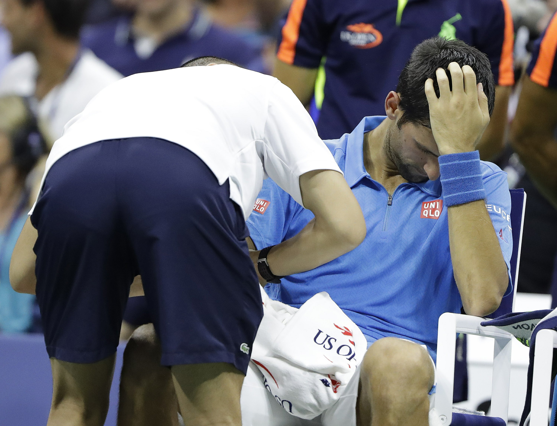 Djokovic's right arm troubles him at US Open; Keys wins