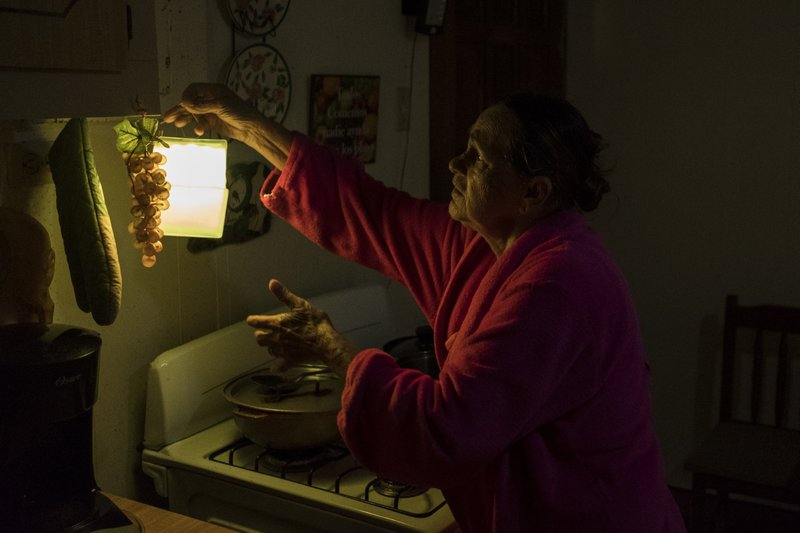 Puerto Ricans cheer return of electricity but remain wary (apnews.com)