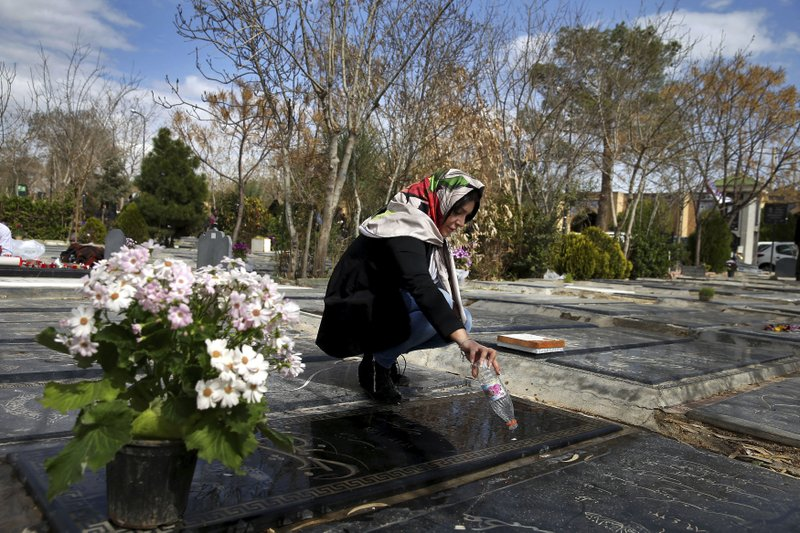 "An Iranian woman cleans grave of her mother at the Behesht-e-Zahra cemetery just outside Tehran, Iran, Monday, March 20, 2017, on the eve of the Iranian New Year, or Nowruz. Nowruz which means ""New Day"" in Persian, marks the first day of spring and the beginning of the year on the Iranian calendar, which occurs exactly on the Spring Equinox."