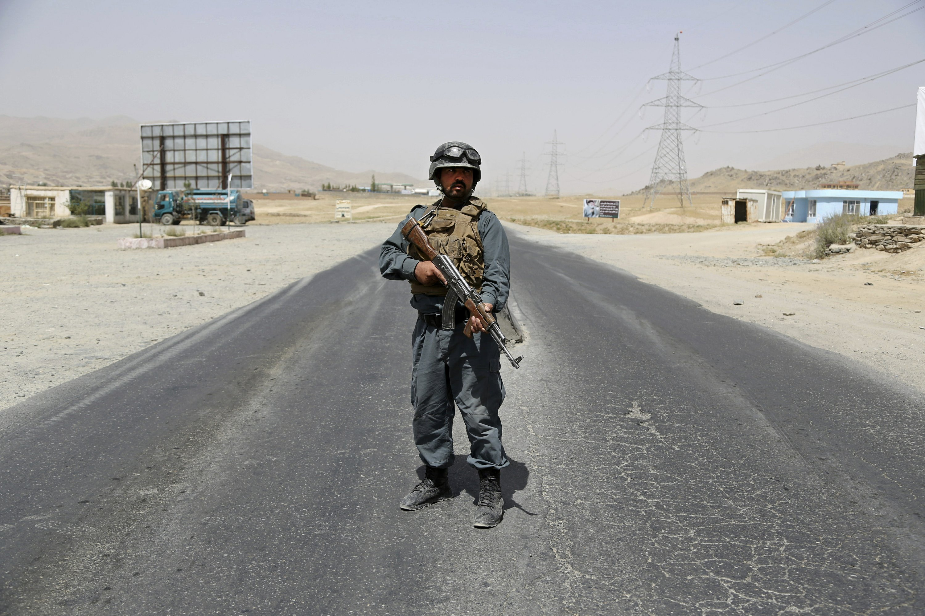 The Latest: Afghan officials: Taliban attack...