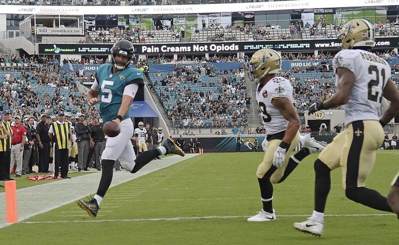 a2a286d982c Jacksonville Jaguars quarterback Blake Bortles (5) runs past New Orleans  Saints defensive backs Kurt Coleman