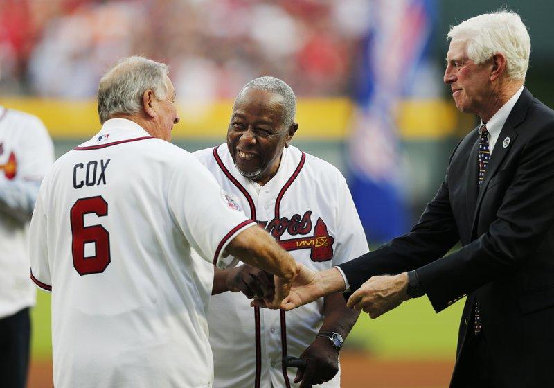 Hank Aaron, Bobby Cox, Terry McGuirk
