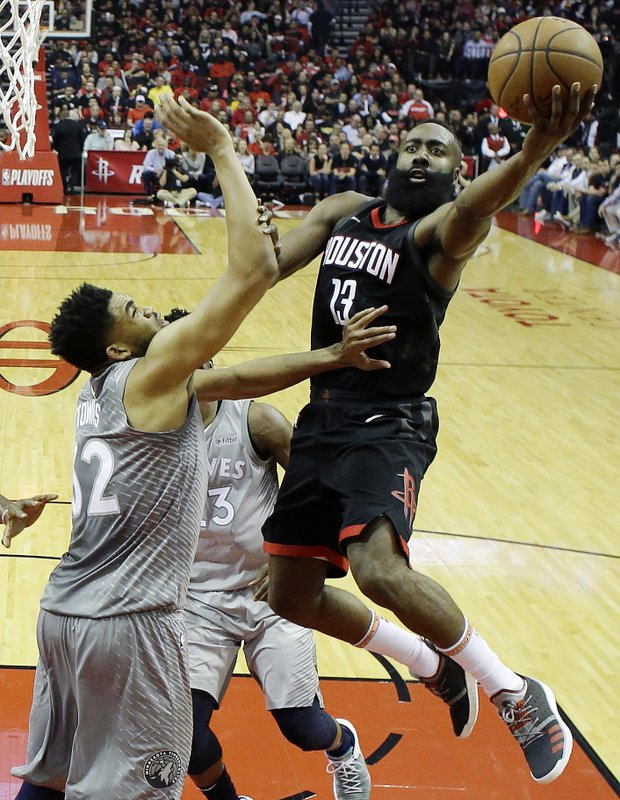 1619c501cf34 Houston Rockets  James Harden shoots over Minnesota Timberwolves   Karl-Anthony Towns during the first half in Game 1 of a first-round NBA  basketball playoff ...