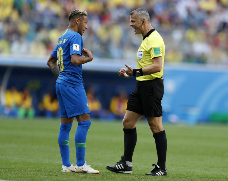 Brazil's Neymar, left, reacts as he talks with referee Bjorn Kuipers from Netherlands during the group E match between Brazil and Costa Rica at the 2018 soccer World Cup in the St. Petersburg Stadium in St. Petersburg, Russia, Friday, June 22, 2018.