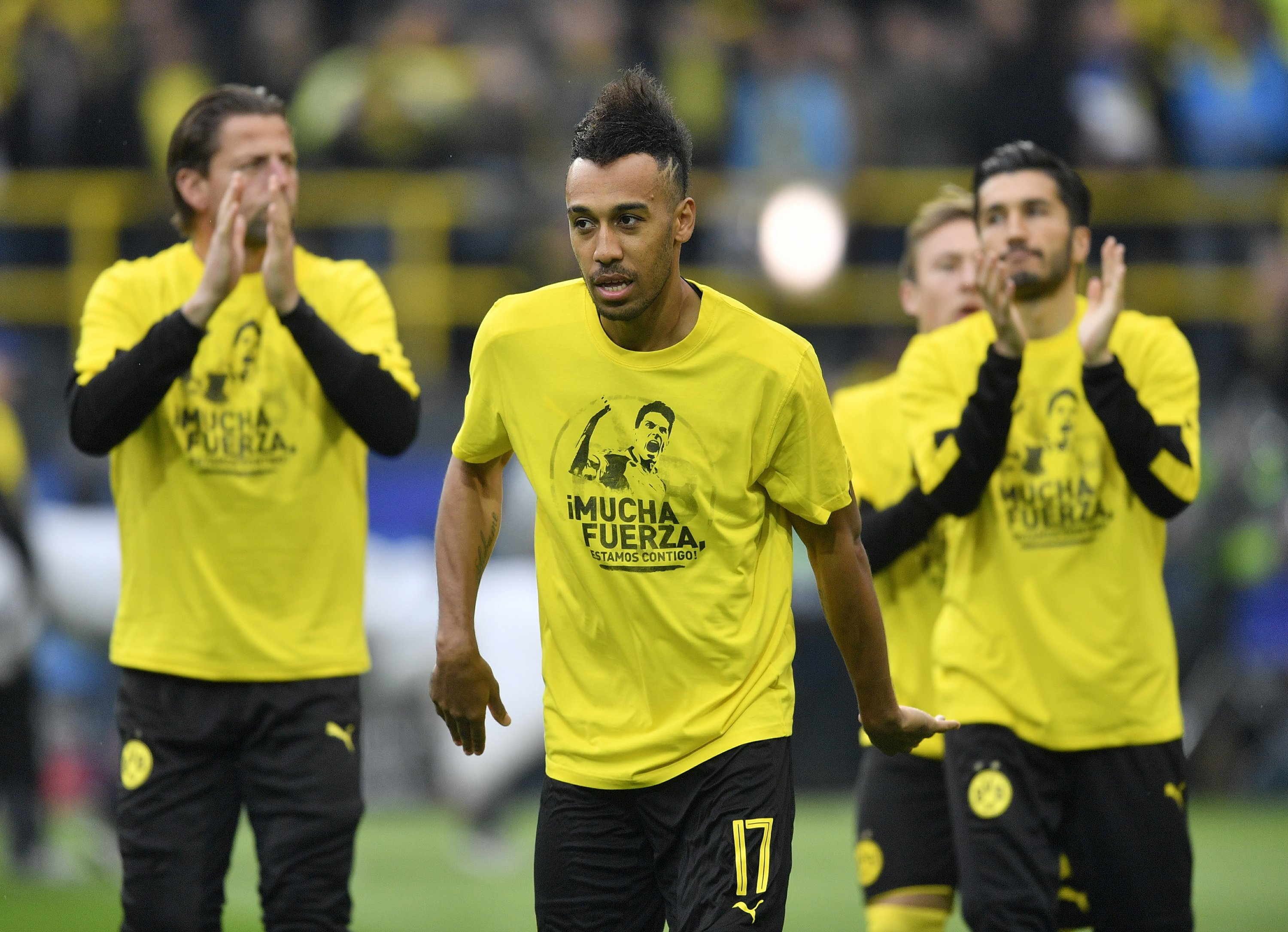 The Latest: Fans cheer Dortmund defender wounded in attack