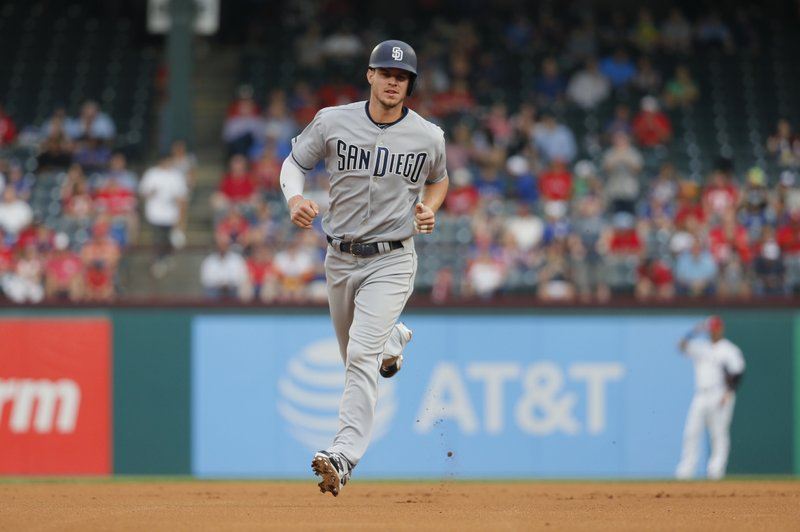 San Diego Padres first baseman Wil Myers rounds the bases after hitting a home run against Texas Rangers pitcher Yu Darvish (11) during the first inning of a baseball game, Wednesday, May 10, 2017, in Arlington, Texas. (AP Photo/Tony Gutierrez)