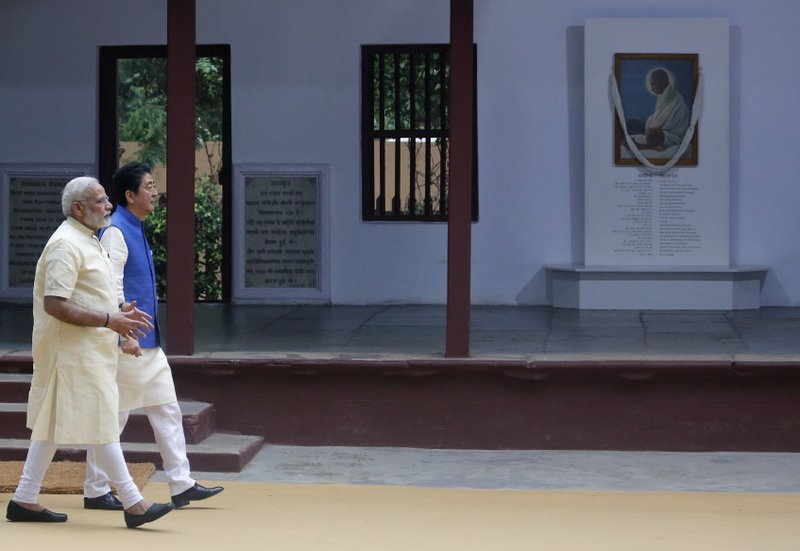 Japanese Prime Minister Shinzo Abe and Indian Prime Minister Narendra Modi visit Sabarmati Ashram, or Gandhi Ashram, in Ahmadabad, India, Wednesday, Sept. 13, 2017. Abe is on a two-day official visit to India.