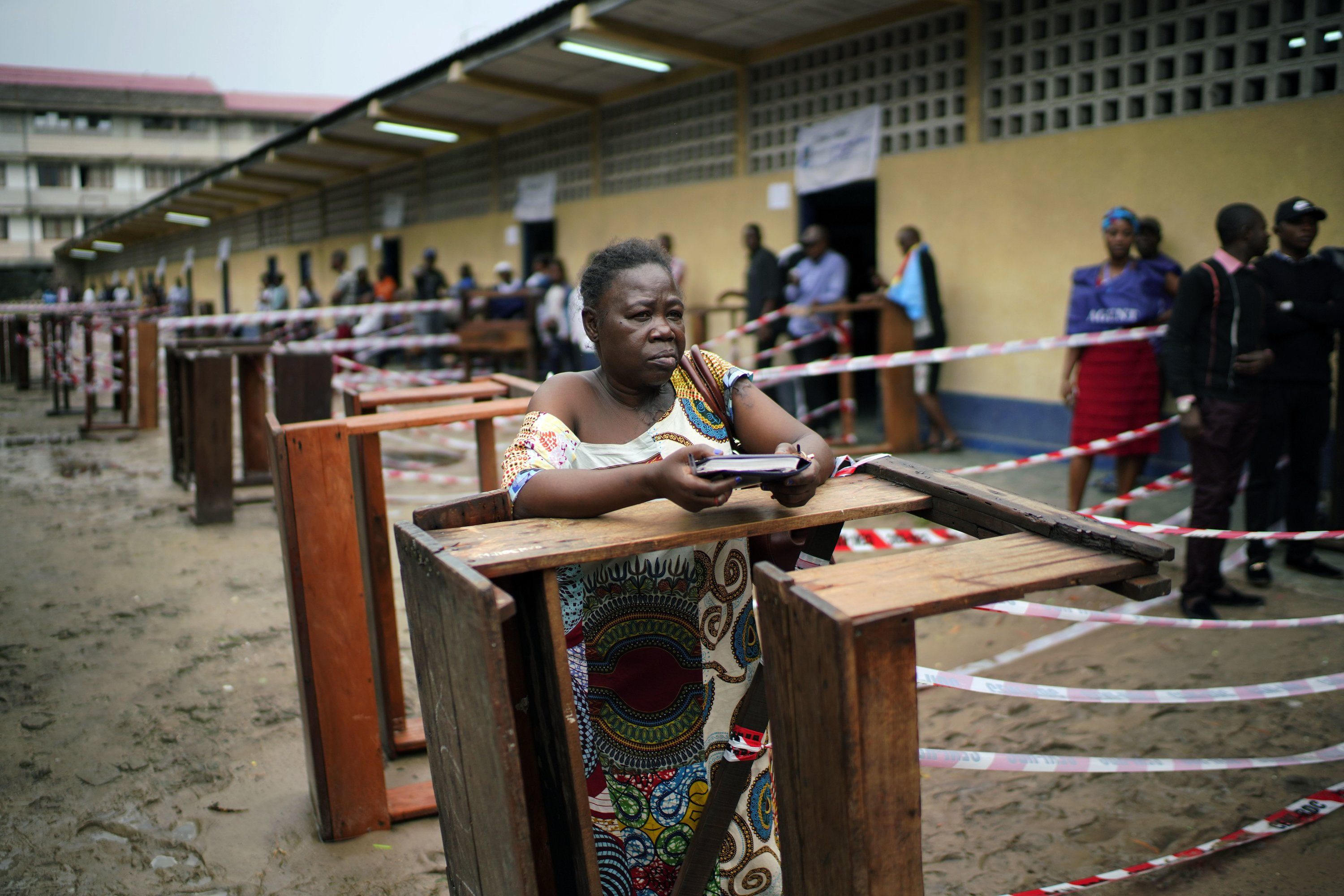 The Latest: As Congo polls close, 1 is just about to open