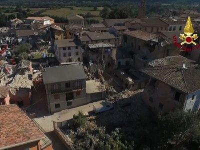 Raw: Italy's PM Tours Earthquake Scene