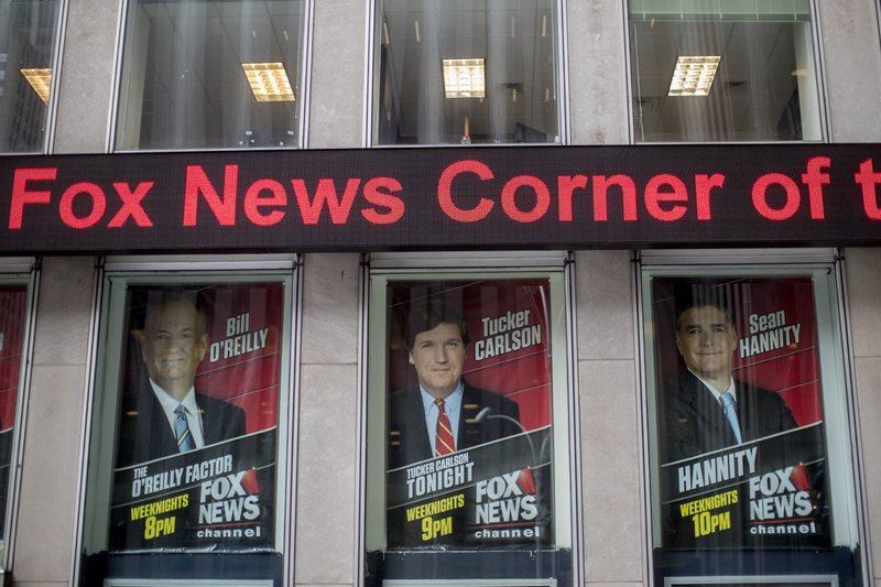 Posters of Fox News Channel personalities are displayed at the News Corp. headquarters in New York, Wednesday, April 19, 2017.