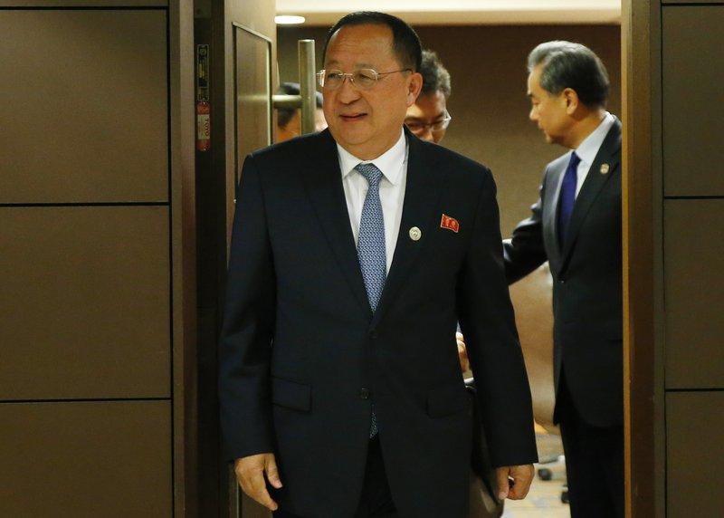Ri Yong Ho,Wang Yi