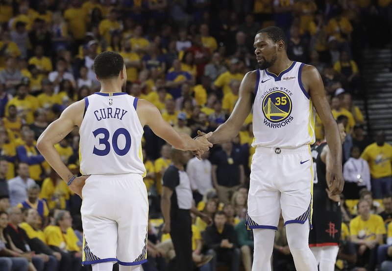 502cd5033adc Durant s 35 points carry Warriors past Rockets in Game 1