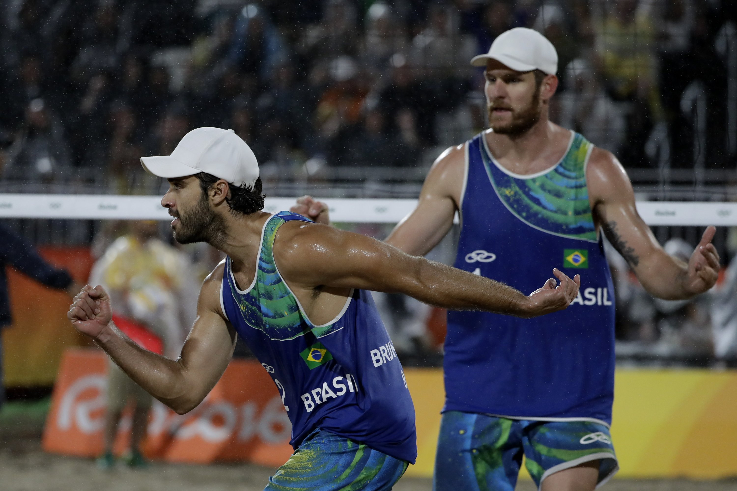 The Latest: Brazil rally to win men's beach volleyball gold