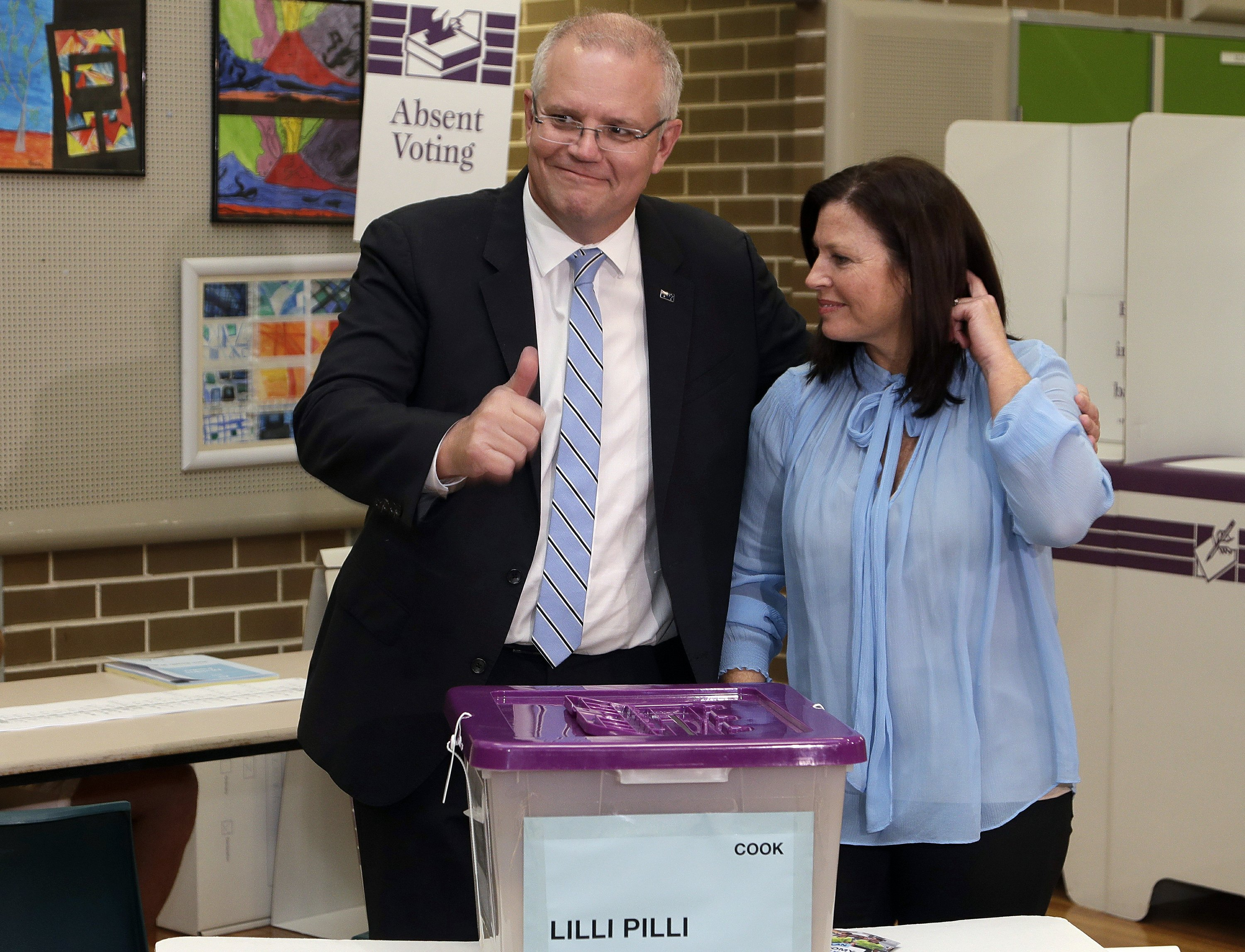 Australia's ruling coalition elected to surprise third term
