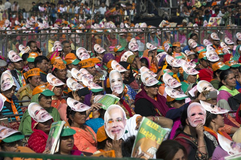 In this Nov. 5, 2017, file photo, people wear masks in the likeness of the Indian Prime Minister Narendra Modi at an election rally in Palampur, south of Dharmsala, India. A series of incidents this fall have reinforced fears that anti-Muslim sentiment has hardened in India in the three years since a right-wing Hindu nationalist party led by Modi swept to power.