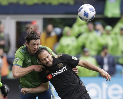 98fb65d28b1 SEATTLE (AP) — Diego Rossi scored in the 11th minute off a pass from Carlos  Vela and expansion Los Angeles FC beat the Seattle Sounders 1-0 on Sunday  in the ...