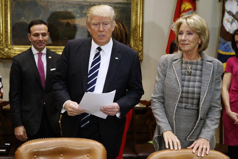 Donald Trump, Justin Trudeau, Betsy DeVos