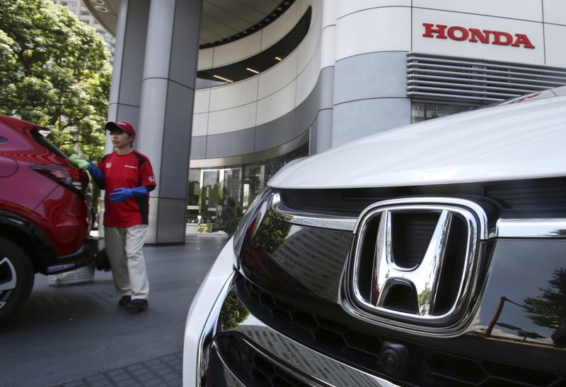 An Employee Of Honda Motor Co Cleans A Car Displayed At Its Headquarters In Tokyo Tuesday July 31 2018 Profits Jumped 178 Percent The