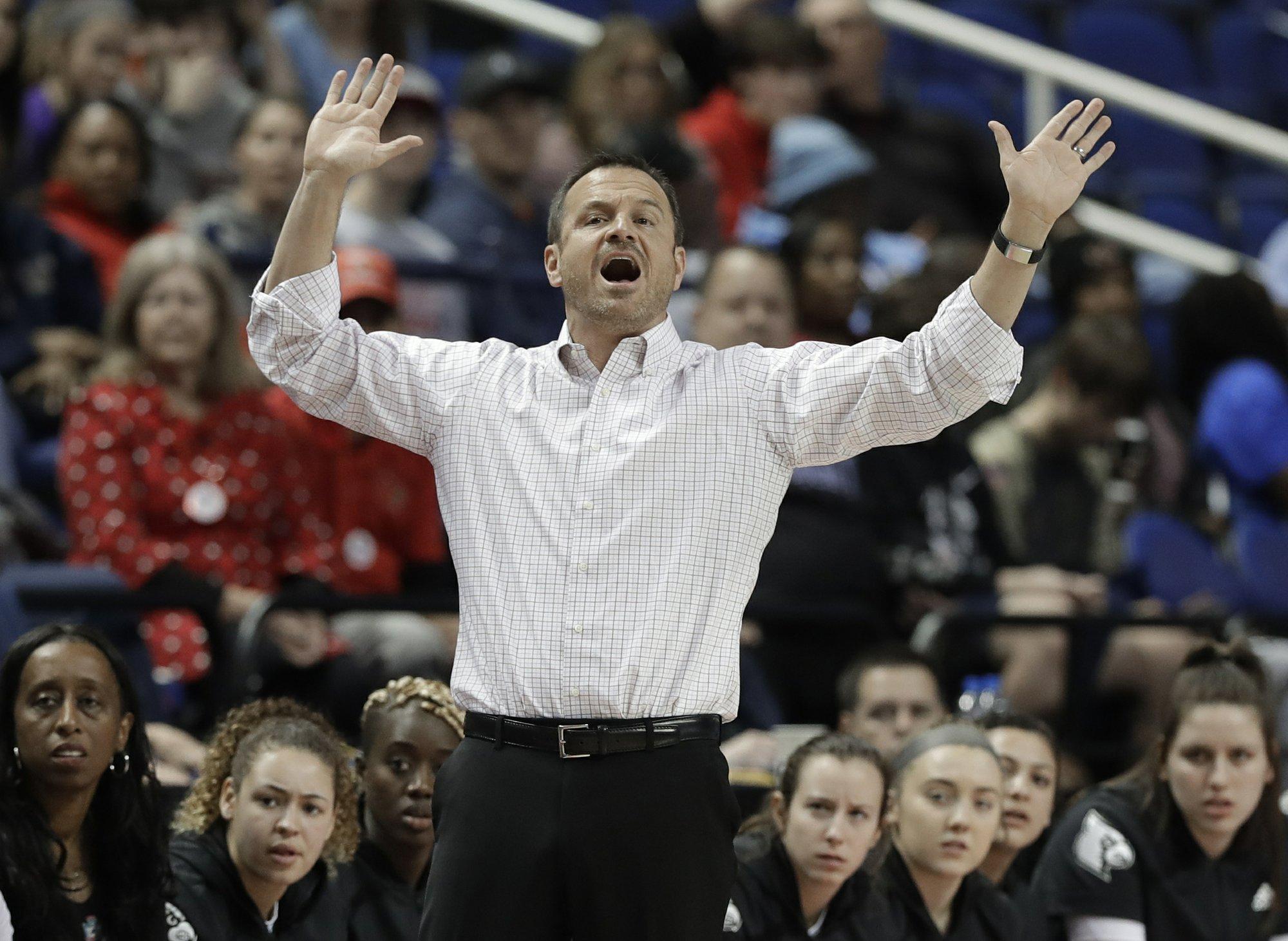 No. 1 seed Louisville begins NCAAs minus coach Jeff Walz