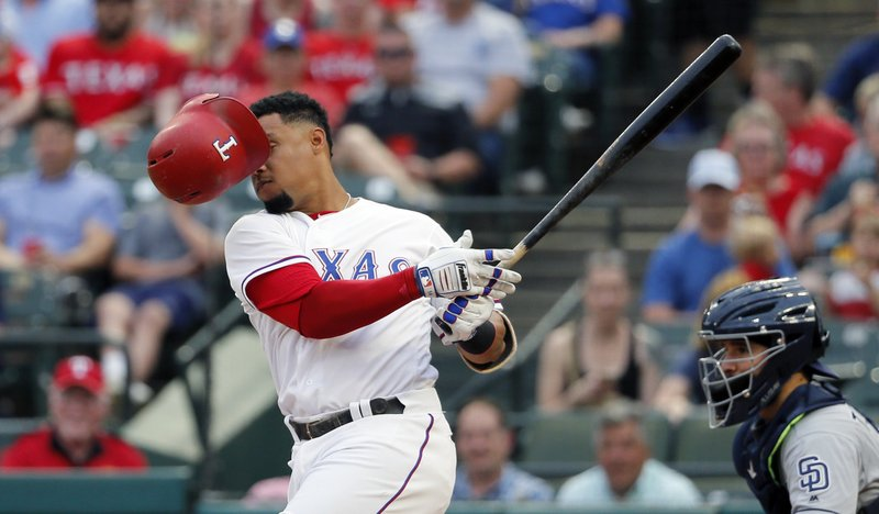 Texas Rangers center fielder Carlos Gomez loses his helmet as he takes a swing for a stake against San Diego Padres starting pitcher Luis Perdomo (61) during the first inning of a baseball game, Wednesday, May 10, 2017, in Arlington, Texas. (AP Photo/Tony Gutierrez)