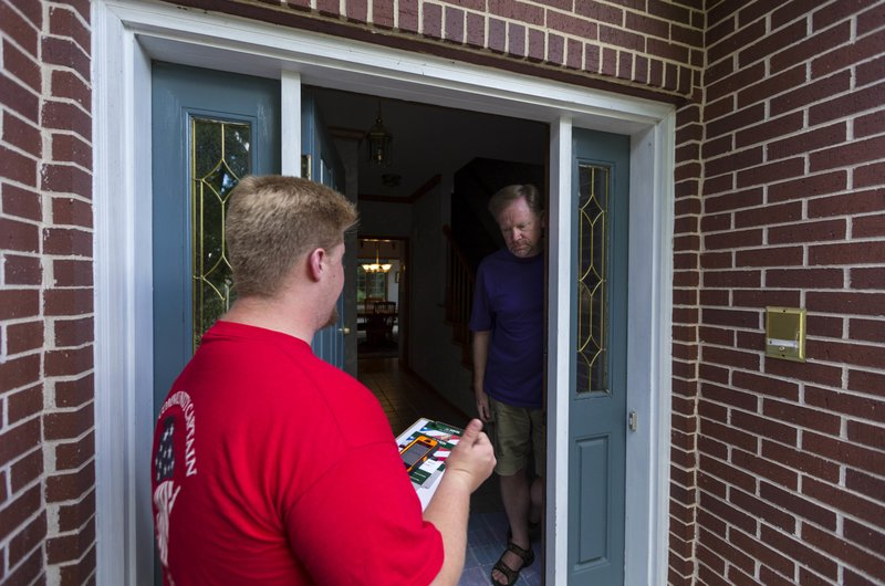 In this photo taken June 29 2016 Wisconsin Republican party door-to-door canvasser Andy Andrews left talks with homeowner Jim Fulton in Fitchburg Wis. & A lot of holes in GOP presidential ground game in key states