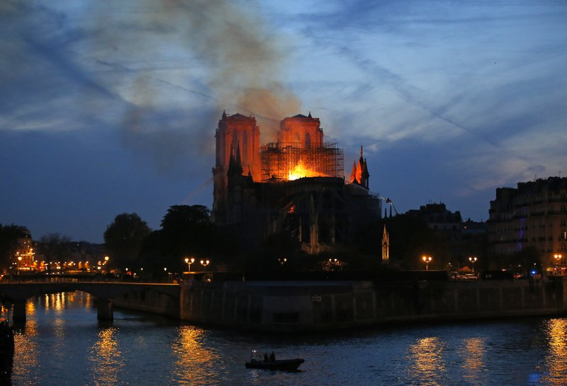 b910c1e143b8 The Latest  French leader vows to rebuild damaged Notre Dame