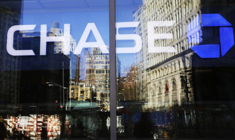 JPMorgan's profits rise 18 percent, helped by lower taxes