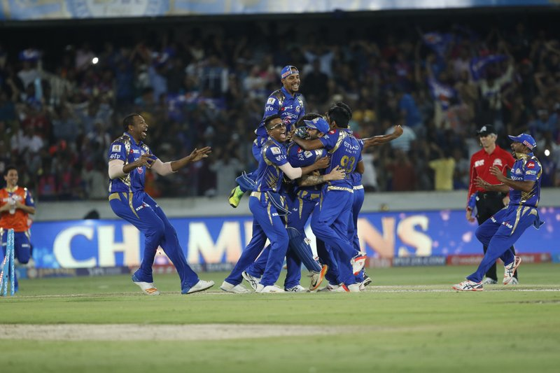Mumbai Indians players celebrate after winning the Indian Premier League (IPL) cricket final against Rising Pune Supergiant in Hyderabad, India, Sunday, May 21, 2017.