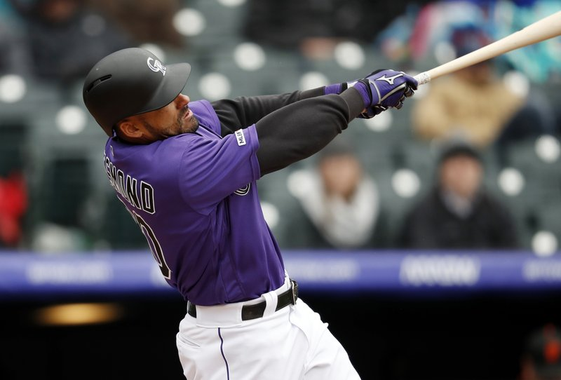 47f7e767f3e Rockies rally to beat Giants 12-11 at wintry Coors Field